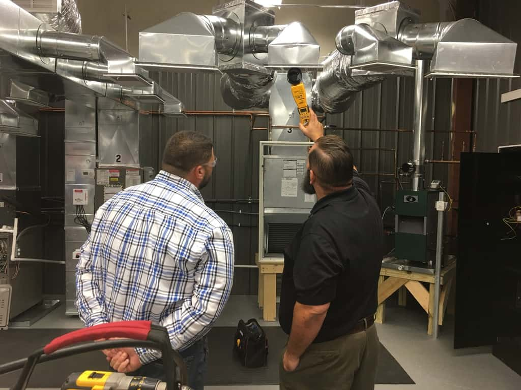 HVAC school student learning about airflow in duct work