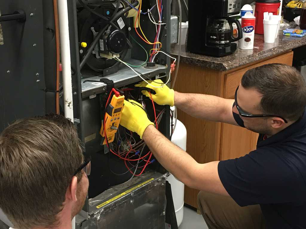 heating and air student learning about electrical wiring